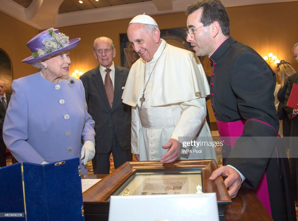 Her Majesty Queen Elizabeth II exchanges gifts with His Holiness, Pope Francis, during an audience in the Pope's study inside the Paul VI Hall on her one-day visit to Rome on April 3, 2014 in Vatican City, Vatican. During their brief visit The Queen and the Duke of Edinburgh will have lunch with Italian President Giorgio Napolitano and an audience with Pope Francis at the Vatican. The Queen was originally due to travel to Rome in April 2013 but the visit was postponed due to her ill health. The audience with Pope Francis will be the fifth meeting The Queen, who is head of the Church of the England, has held with a Pope in the Vatican. .