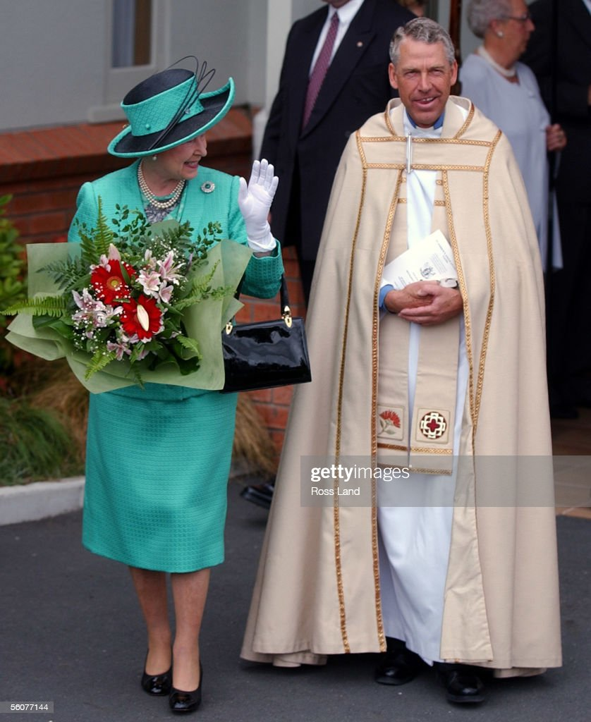 Her Majesty Queen Elizabeth II smiles at waiting fans as she walks with Reverend Geoff Hickman, Vicar of St Andrews, after she and the Duke Of Edinburgh attended a church service at St Andrews Anglican Church in Taupo. The Queen is in New Zealand on a five day official visit, her 10th to the country.