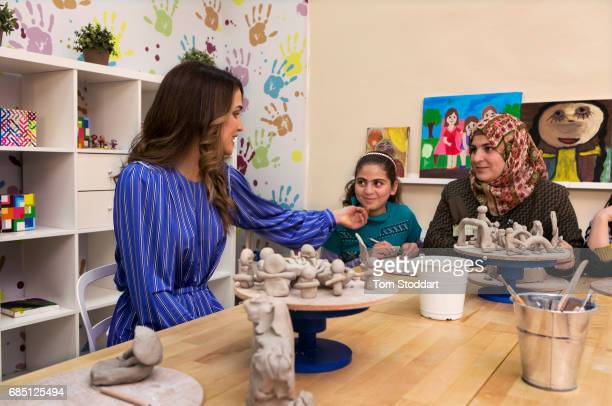 Her Majesty Queen Rania Al Abdullah of Jordan photographed during a visit to the Queen Rania Family and Child Centre in the Jabal Al Nasr district of...