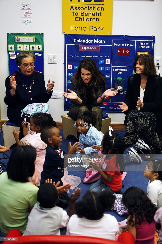 Her Majesty Queen Rania Al-Abdullah (C) of Jordan along with with Children's Defense Fund President Marion Wright Edelman (L) and ABC President Gretchen Buchenholz (R) play with children at the Association to Benefit Children's new Echo Park children and family facility in Harlem September 20, 2006 in New York City. Queen Rania and Marion Wright Edelman set in motion the Global Women's Action Network for Children last June in Jordan.