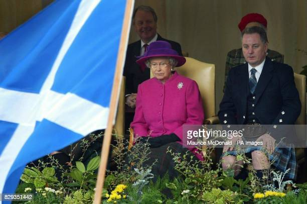 Her Majesty the Queen accompanied by First Minister Jack McConnell watch the opening ceremony to mark the official opening of the new Scottish...