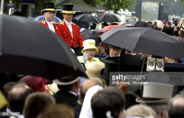Her Majesty The Queen accompanied by the Duke of Edinburgh arrives amid a down pour at Royal Ascot She was heading the field at the start of a...