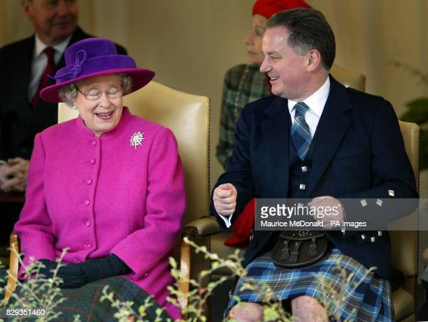 Her Majesty the Queen and First Minister Jack McConnell share a joke during the official opening of the new Scottish Parliament building at Holyrood...