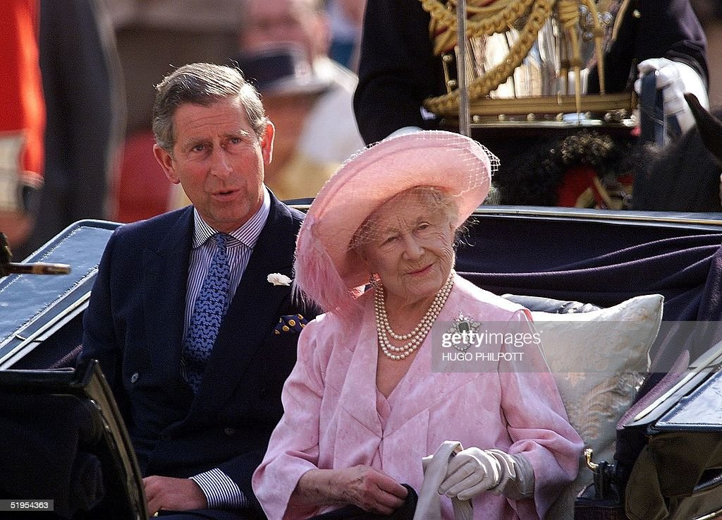 Her majesty the Queen mother arrives in a horse drawn carriage with her grandson Prince Charles for her centenary party at Horse guards parade in...