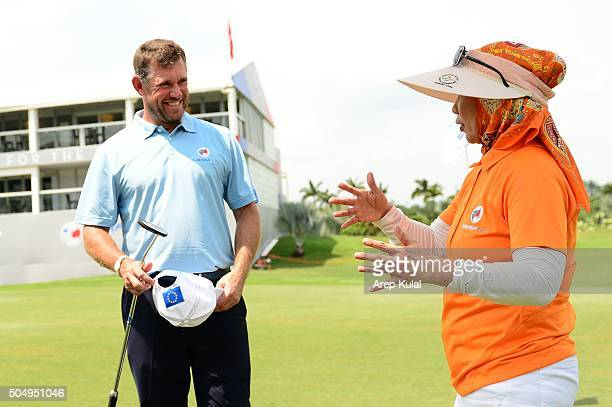 Her Majesty The Raja Agong Tuanku Hajah Haminah The Queen of Malaysia chats with Lee Westwood of Team Europe during the ProAM Tournament ahead of...