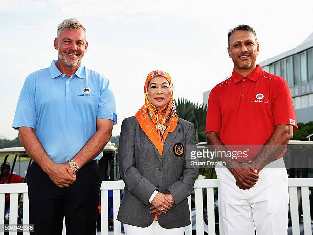 Her Majesty The Raja Permaisuri Agong Tuanka Hajah Haminah Hamidun The Queen of Malaysia poses with Darren Clarke Captain of team Europe and Jeev...