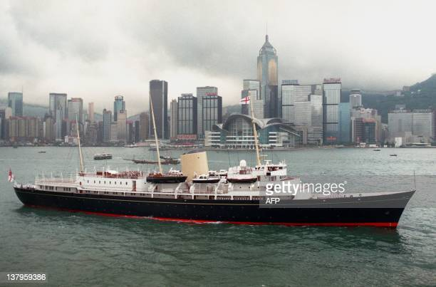 Her Majesty's Ship the royal yacht Britannia steams past the new extension of the Hong Kong Convention and Exhibition Center where the handover...