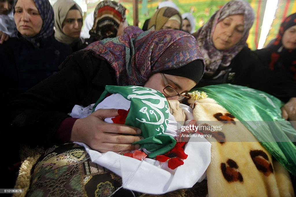 Her relatives mourn around the body of 17-year-old Palestinian girl Kalzar El-Uveivi, who has been killed by Israeli soldiers in alleged knife attack, during the funeral ceremony in Hebron, West Bank on February 14, 2016.