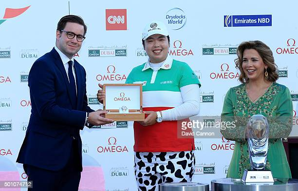 Her Royal Highness Princess Haya looks on as the 2015 champion Shanshan Feng of China is presented with her winners watch by Henri Burrus the Area...