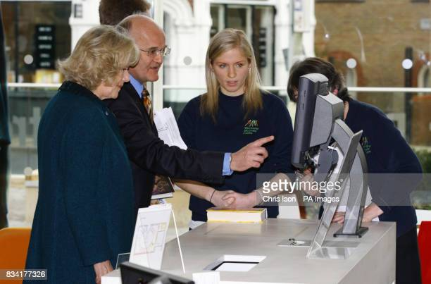 Her Royal Highness the Duchess of Cornwall learns how to borrow a book in the 21st century during a visit to the new Discovery Centre in Winchester