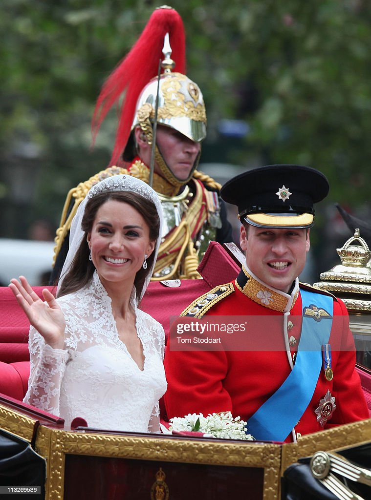 Her Royal Higness Catherine, Duchess of Cambridge waves to the crowds next to His Royal Highness Prince William, Duke of Cambridge as they make the journey by carriage procession to Buckingham Palace past crowds of spectators following their marriage at Westminster Abbey on April 29, 2011 in London, England. The marriage of the second in line to the British throne was led by the Archbishop of Canterbury and was attended by 1900 guests, including foreign Royal family members and heads of state. Thousands of well-wishers from around the world have also flocked to London to witness the spectacle and pageantry of the Royal Wedding.