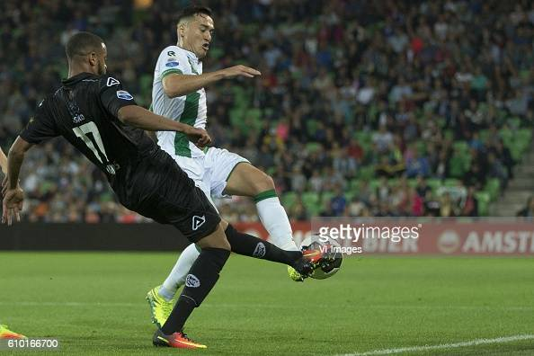 Heracles Almelo Brandley Kuwas of Heracles Almelo Jason Davidson of FC Groningen during the Dutch Eredivisie match between FC Groningen and Heracles...