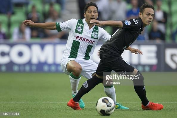 Heracles Almelo Tom Hiariej of FC Groningen Jaroslav Navratil of Heracles Almelo during the Dutch Eredivisie match between FC Groningen and Heracles...