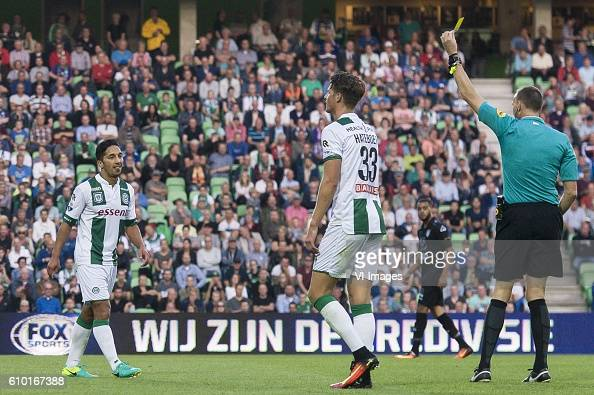 Heracles Almelo Yellow card Tom Hiariej of FC Groningen during the Dutch Eredivisie match between FC Groningen and Heracles Almelo at Euroborg on...