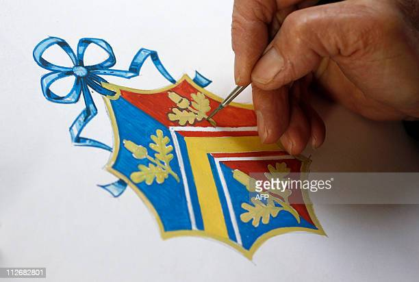 Herald Painter Robert Parsons sketches the new Coat of Arms for Kate Middleton's family at the College of Arms in London on April 18 2011 For a...