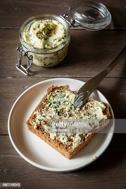 Herb butter, slice of spelt bread on plate