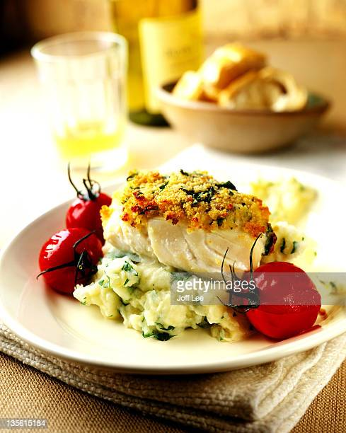 Herb crusted cod with mash & tomatoes