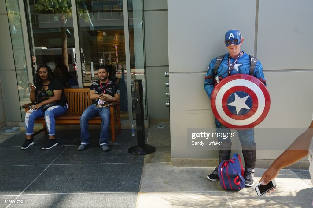 Herb Walker dressed as Captain America stands in the Gaslamp Quarter across from the San Diego Convention Center during Comic Con International in San Diego, California on Thursday, July 20, 2017. Comic Con International is North America's largest Comic convention featuring pop culture and entertainment elements across virtually all genres, including horror, animation, anime, manga, toys, collectible card games, video games, webcomics, and fantasy novels as well as movie premieres and actor panels.