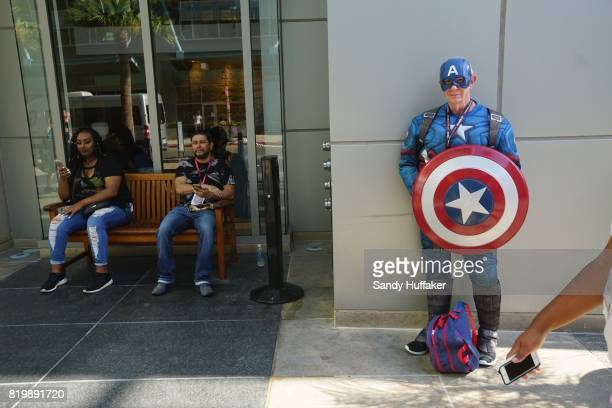 Herb Walker dressed as Captain America stands in the Gaslamp Quarter across from the San Diego Convention Center during Comic Con International in...