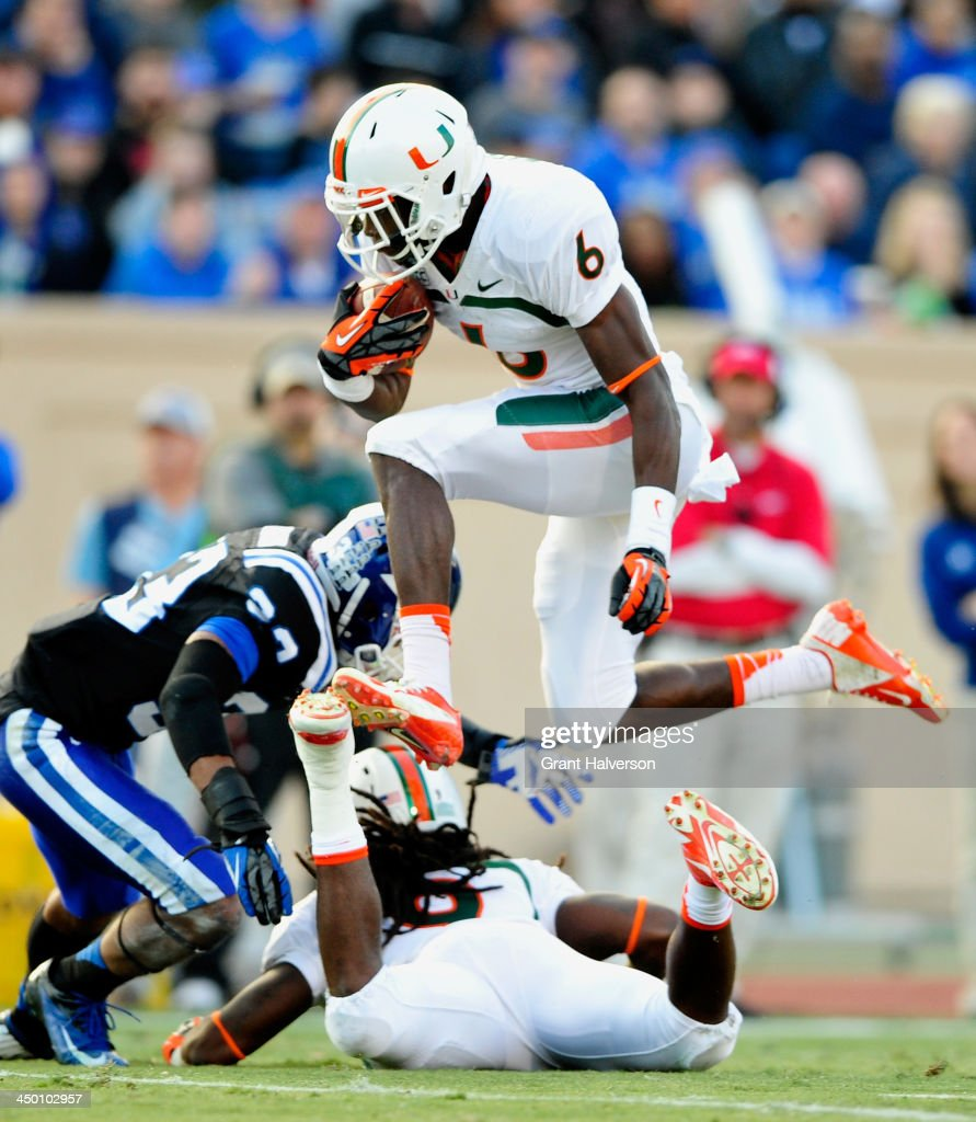 Herb Waters #6 of the Miami Hurricanes hurdles a teammate as he rushes for a first down against the Duke Blue Devils during play at Wallace Wade Stadium on November 16, 2013 in Durham, North Carolina.