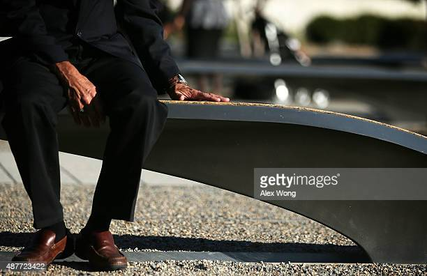 Herb Wolk of Columbia Maryland touches the bench that is dedicated to his soninlaw Lt Darin H Pontell who lost his life during the 9/11 Pentagon...