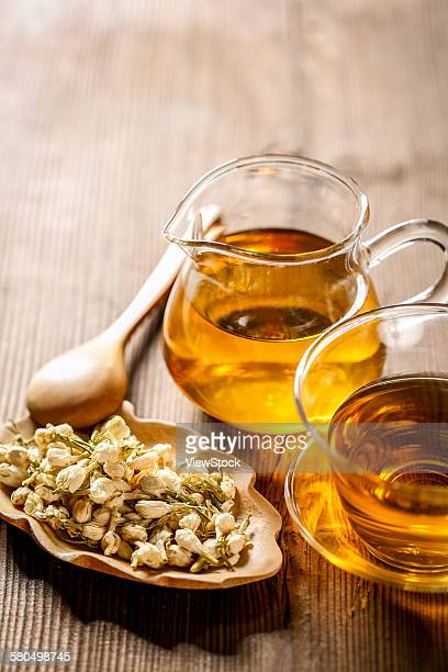 Herbal tea in a glass cup and flowers
