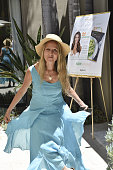 Herbalist/nutritional consultant Brigitte Mars takes a bow at Rainbeau Mars E Book Brunch Celebration on July 22 2016 in Beverly Hills California