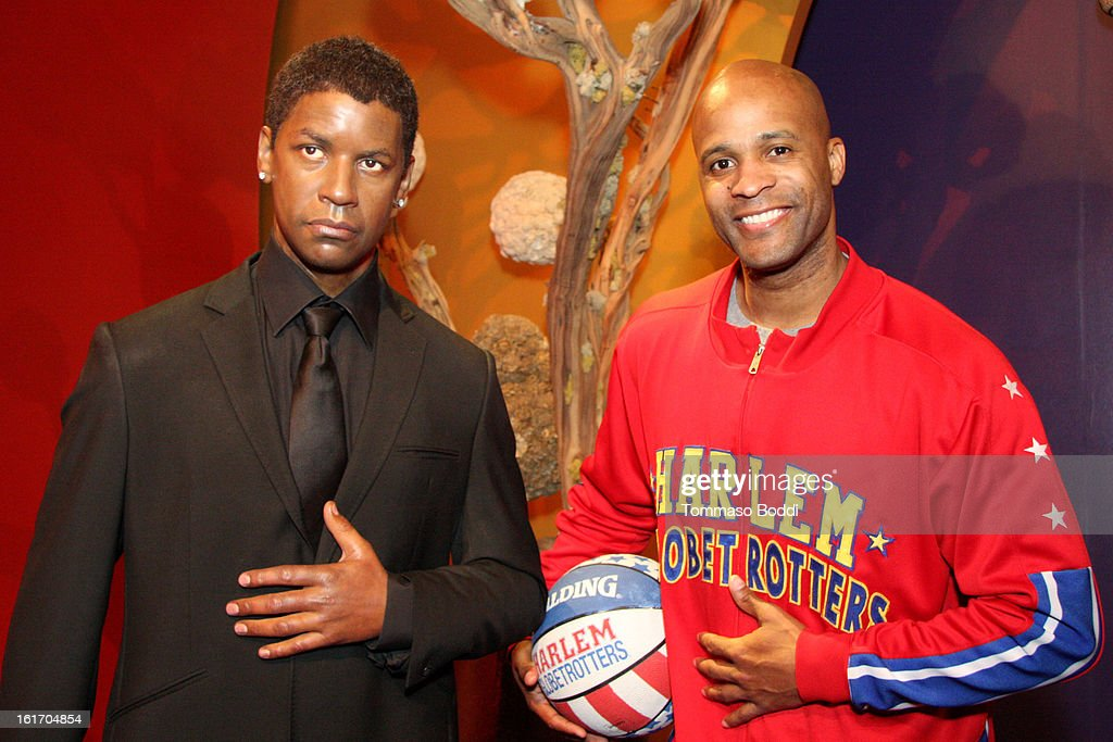 Herbert 'Flight Time' Lang makes an appearance alongside a model of actor Denzil Washington at world's most famous Madame Tussauds Wax Museum on February 14, 2013 in Hollywood, California.