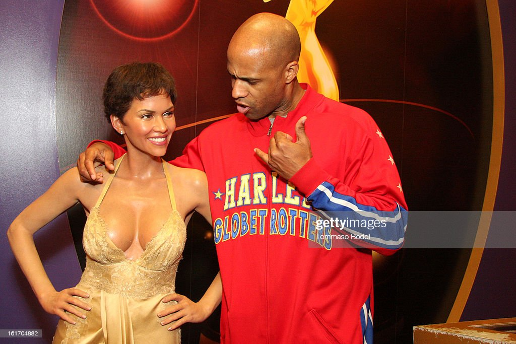 Herbert 'Flight Time' Lang makes appearance alongside a model of actress <a gi-track='captionPersonalityLinkClicked' href=/galleries/search?phrase=Halle+Berry&family=editorial&specificpeople=201726 ng-click='$event.stopPropagation()'>Halle Berry</a> at world's most famous Madame Tussauds Wax Museum on February 14, 2013 in Hollywood, California.