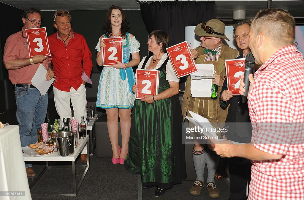 Herbert Frei, Alexander Klement, Roxanne Rapp, Herzerl Mitzi, Conrad Seidl and Christian Feldhofer pose for a photograph during the beauty competition 'Miss Wiener Wiesn-Fest 2014' at Platzhirsch on on June 12, 2014 in Vienna, Austria.