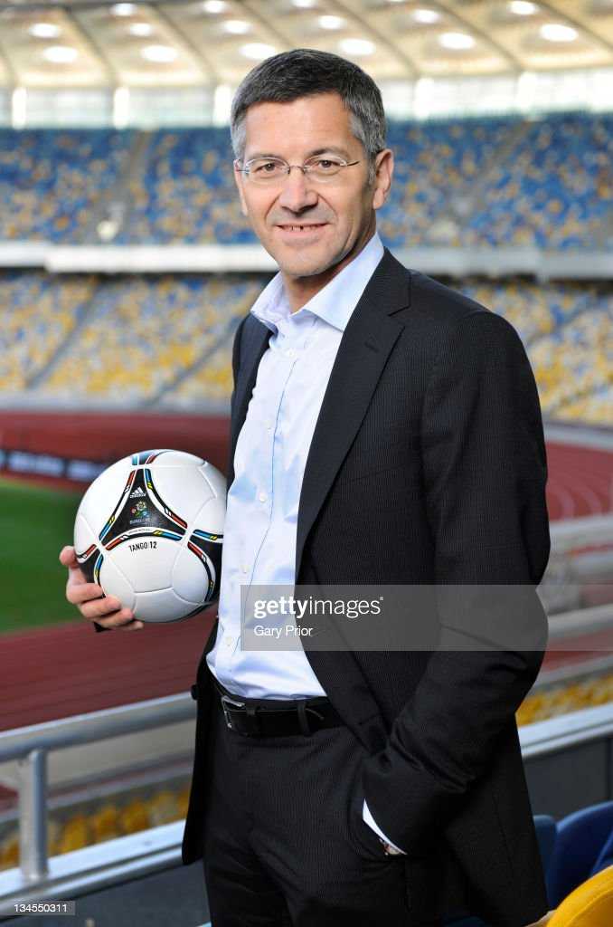 Herbert Hainer, CEO adidas Group poses with the adidas Tango 12, the official matchball for the UEFA Euro 2012 tournament at the Olympiyskiy Stadium on December 2, 2011 in Kiev, Ukraine.