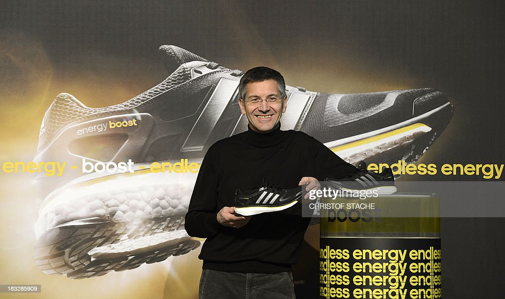 Herbert Hainer, CEO of German sportswear and equipment maker Adidas poses with the new running shoe 'Boost' ahead of the yearly results press conference on March 7, 2013 in Herzogenaurach, southern Germany. Adidas said that one-off writedowns hit its bottom line in 2012, but underlying profits increased due to higher sales. AFP PHOTO / CHRISTOF STACHE
