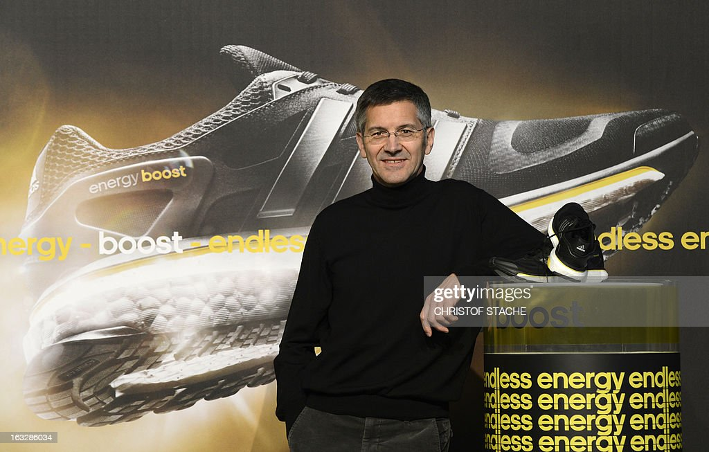 Herbert Hainer, CEO of German sportswear and equipment maker Adidas poses with the new running shoe 'Boost' ahead of the yearly results press conference on March 7, 2013 in Herzogenaurach, southern Germany. Adidas said that one-off writedowns hit its bottom line in 2012, but underlying profits increased due to higher sales.