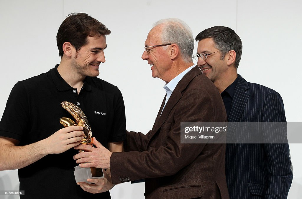 Herbert Hainer (R), the adidas Group CEO, and FIFA executive committee member Franz Beckenbauer (C) hand over the adidas Golden Glove to Iker Casillas (L) during the FIFA 2010 World Cup adidas Golden Award ceremony at the adidas headquarters on December 14, 2010 in Herzogenaurach, Germany.