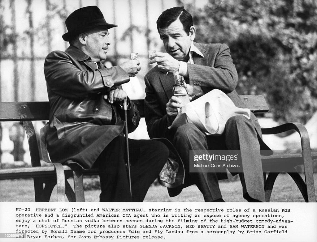 Herbert Lom and Walter Matthau enjoy shots of Vodka in between scenes of the film 'Hopscotch', 1980.