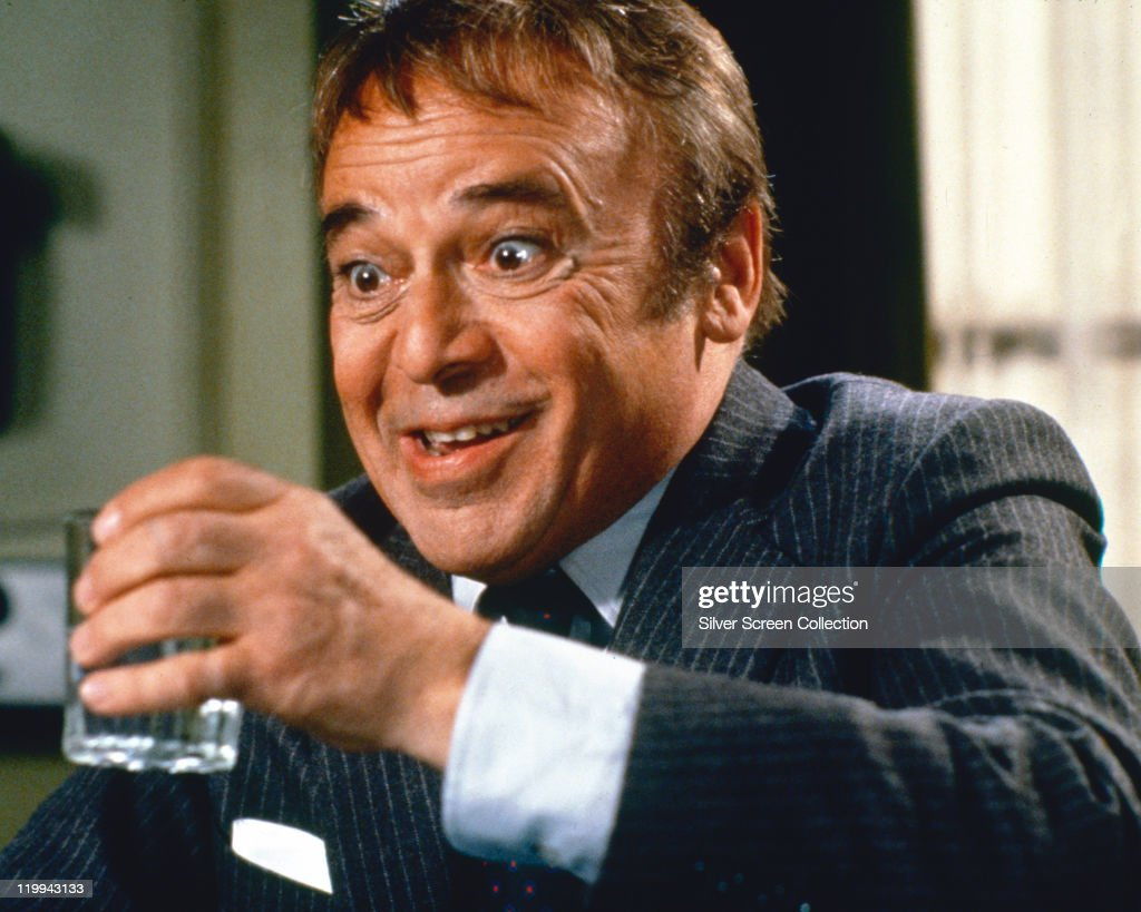 Herbert Lom, Czech actor, holding a drinking glass in a publicity still issued for the film, '99 Women', 1969. The prison drama, directed by Jesus Franco, starred Lom as 'Governor Santos'.