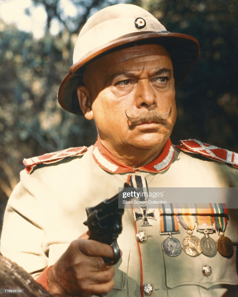 Herbert Lom, Czech actor, wearing German military uniform while holding a handgun in a publicity still issued for the film, 'King Solomon's Mines', 1985. The adventure film, directed by J. Lee Thompson (1914–2002), starred Lom as 'Colonel Bockner'.