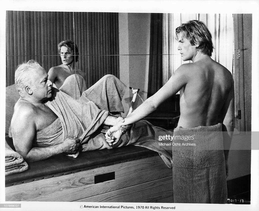 Herbert Lom grabs Helmut Berger in a scene from the film 'Dorian Gray', 1970.