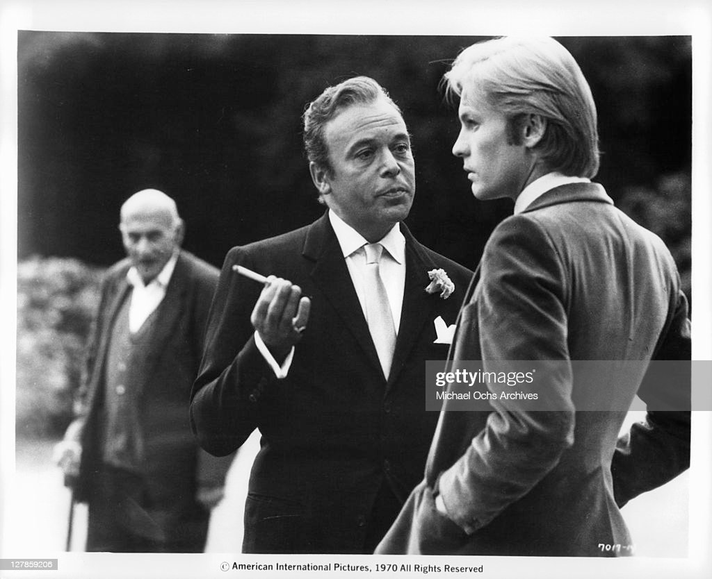 Herbert Lom meets with Helmut Berger in a scene from the film 'Dorian Gray', 1970.