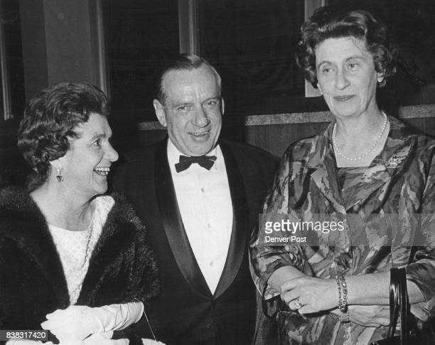 Herbert Mueller escorted Mrs Leonard V B Sutton left and Baroness Sigismund won Bibra of West Germany to Bonfils Theatre opening night Credit Denver...