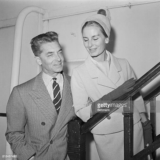 Herbert Von Karajan world famous conductor of the Berlin Philharmonic Orchestra arrives aboard the Queen Mary With him is his wife The German...