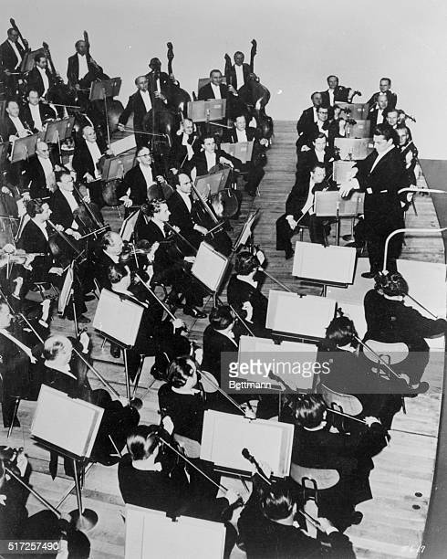 Herbert Von Karajan world renown orchestral leader and conductor of the Berlin Philharmonic Symphony is shown conducting orchestra