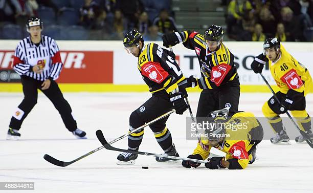 Herberts Vasiljevs Andreas Driendl and Rafael Rotter are fighting for the puck during the Champions Hockey League group stage game between Krefeld...