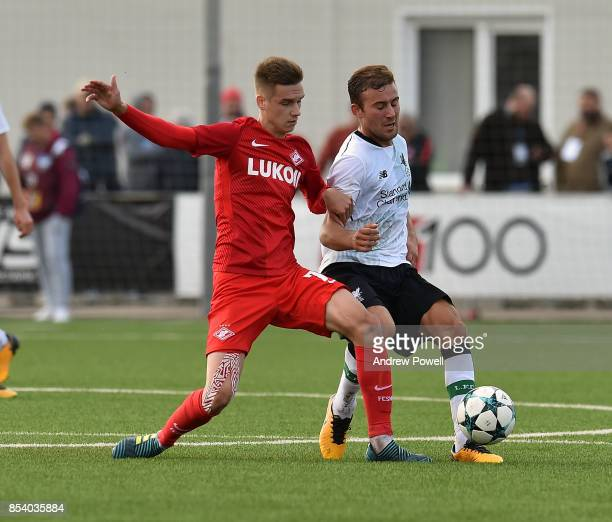 Herbie Kane of Liverpool competes with Maksim Kalachevskii of Spartak Moskva during the UEFA Youth League match between Spartak Moskva and Liverpool...