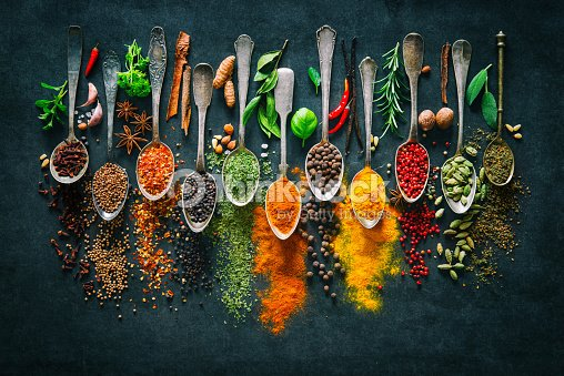 Herbs and spices for cooking on dark background : Stock Photo