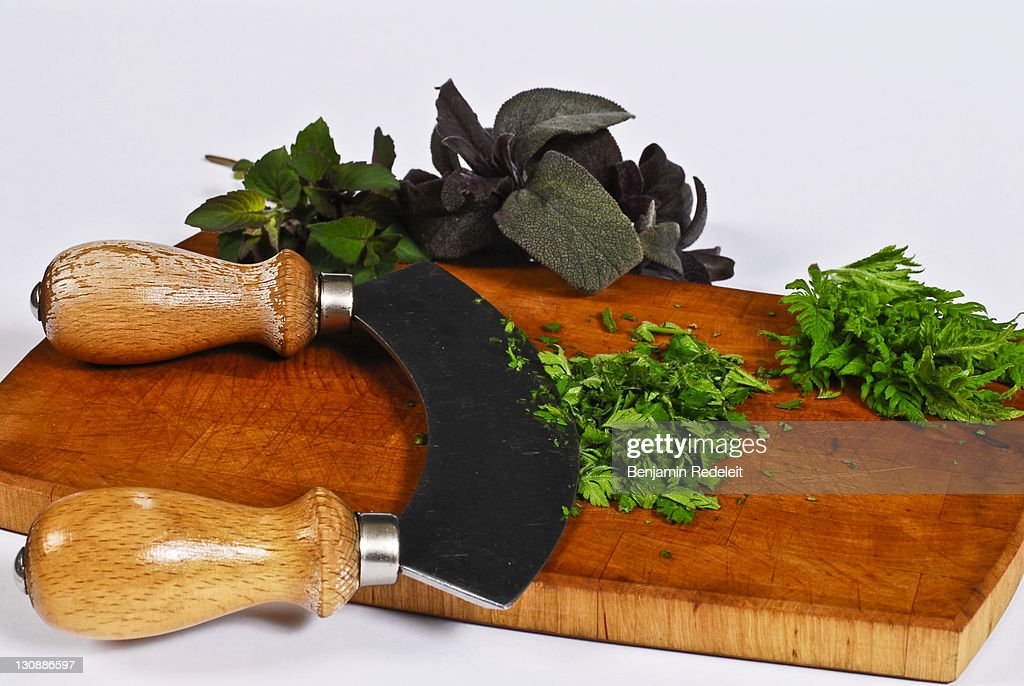 Herbs, Calamintha, Cicely, Salvia get cut with a mincing knife