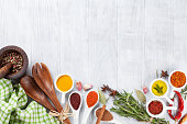 Herbs, condiments and spices on wooden background. Top view with copy space