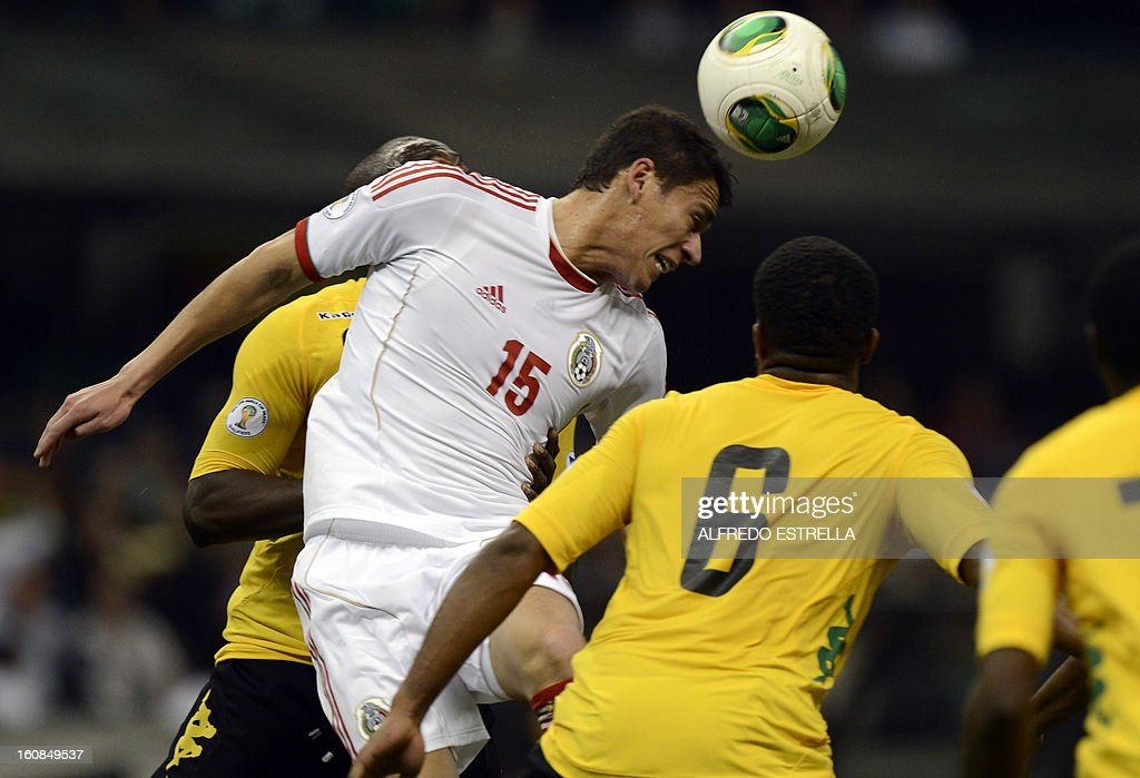 Herctor Moreno (L) of Mexico vies for the ball with Jermaine Taylor (R) of Jamaica during their Brazil-2014 FIFA World Cup CONCACAF football qualifier at Azteca Stadium in Mexico City, on February 6, 2013. AFP PHOTO/Alfredo Estrella