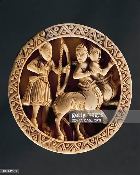 Hercules battling centaurs walrus ivory checker piece Albans school England 12th century Florence Museo Nazionale Del Bargello