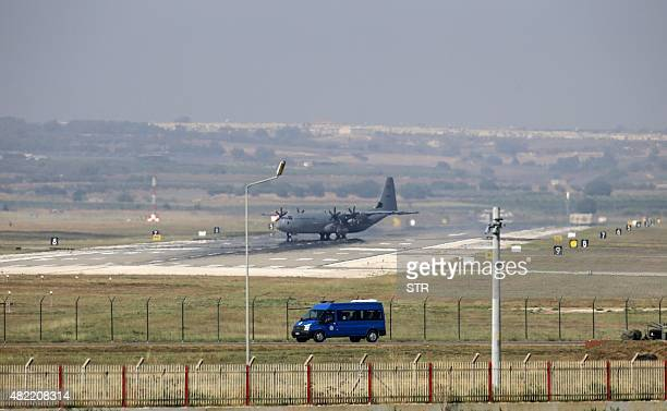 A Hercules C130 military aircraft maneuvres on the runway at Incirlik Air Base in the outskirts of the city of Adana southeastern Turkey on July 28...